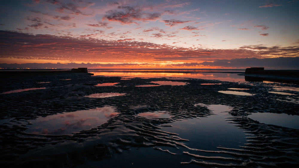 Stingray holes at sunrise on the Sandgate waterfront.
