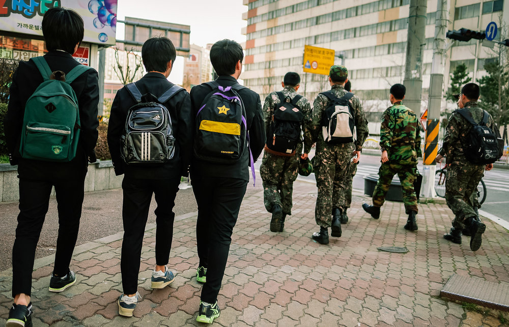 Falling Into Step, Jangyu. The three schoolboys, like me, were trudging towards Naedeok Middle School, where I worked Thursdays & Fridays. The soldiers represent their future - military service is compulsory in Korea. Hard to imagine who was most depressed here, but I'd say probably me.