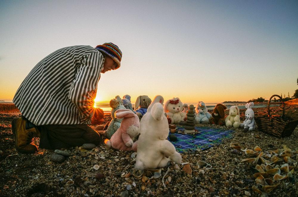 Local identity Rick Thomson-Jones prepares his Easter installation on the Brighton seashore, 2014.