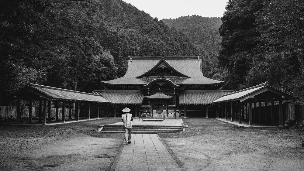 Day 11: A pilgrim approaching the main hall of temple #64, Maegami-ji, Ehime.