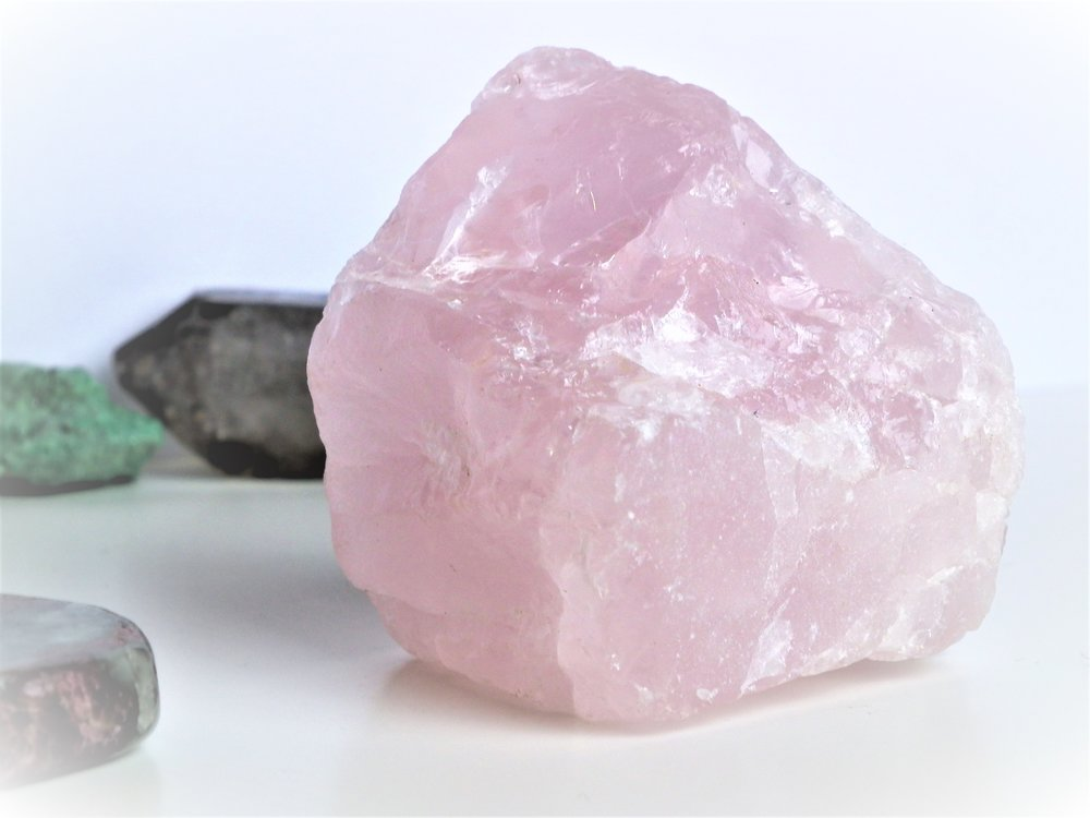 rose-quartz-crystals Crystals meaning crystals and stones crystal healing crystals for beginners how to use crystals crystal magic chakras throat chakra root chakra energy spirituality spiritual healing crystals gemstones gems stones