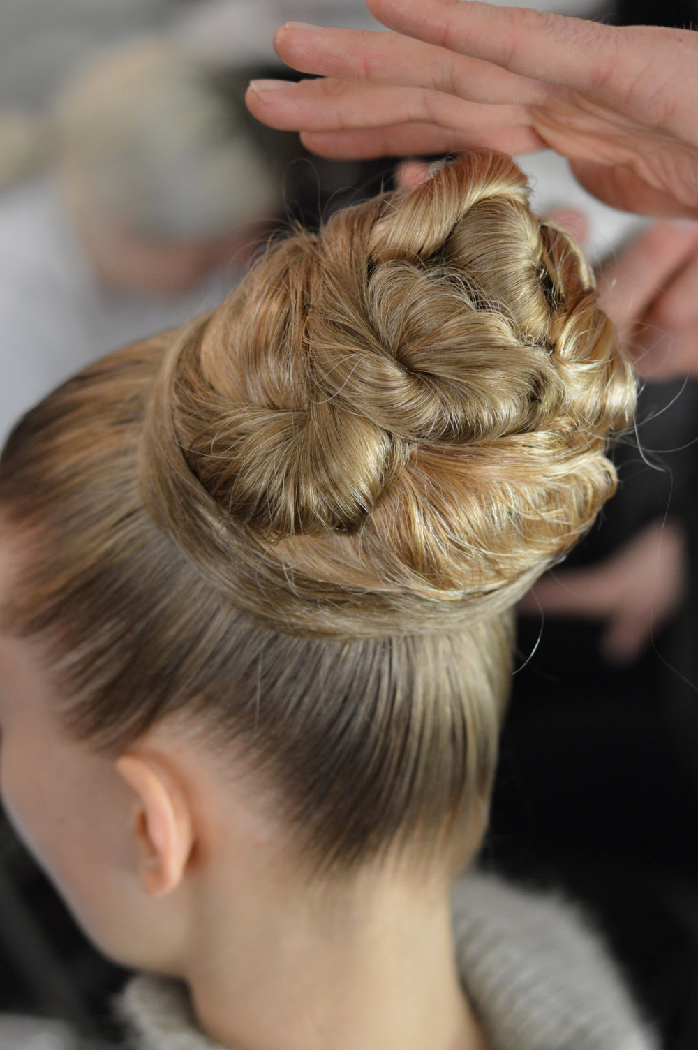 Sky high buns  #backstage  at  Carolina Herrera    Hair by Orlando Pita with Bio Sleek    Image via  kristindee_  with Cult of Pretty