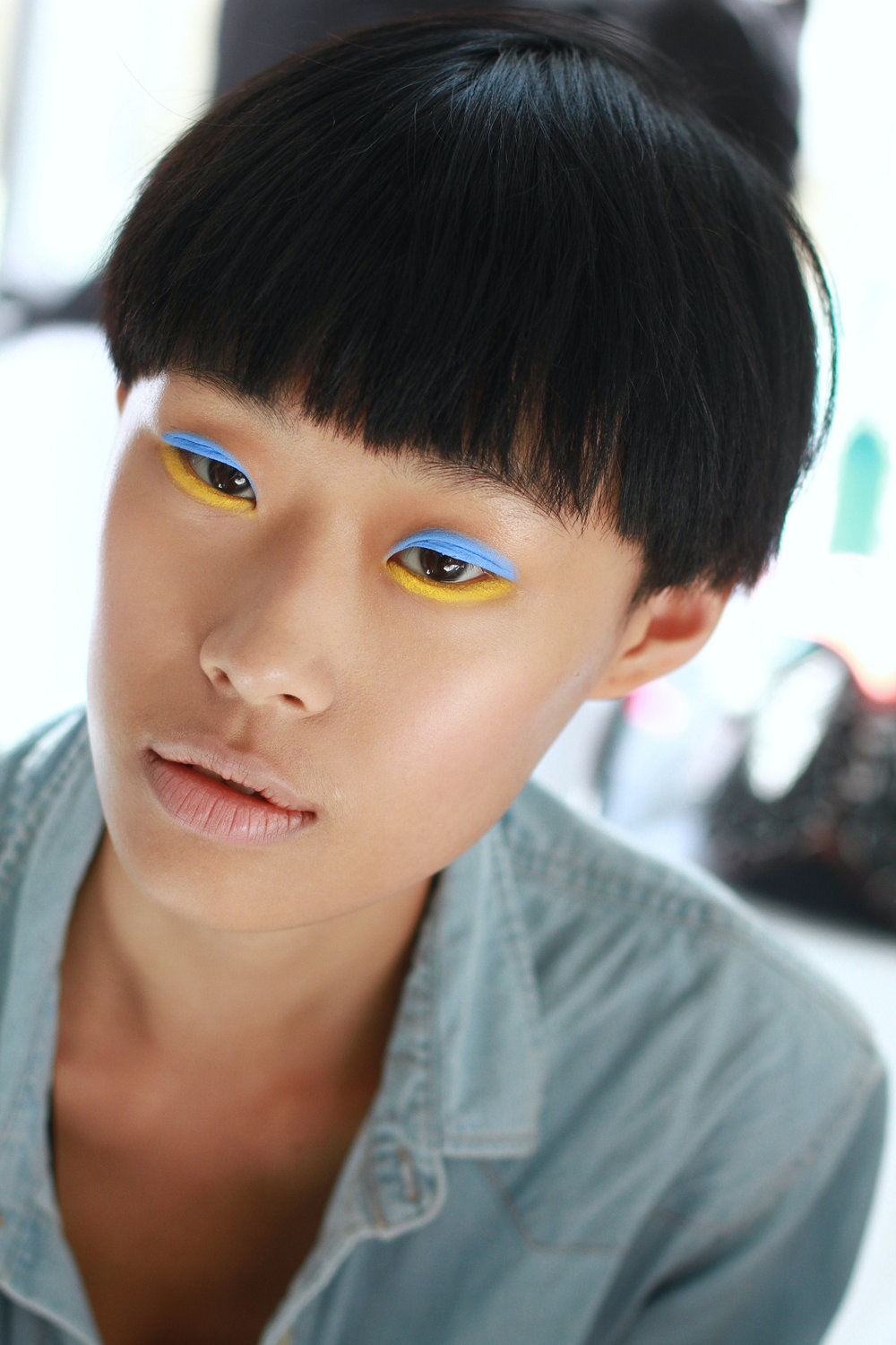 Backstage at Delpozo #NYFW.  blue + yellow lines Hair by Morrocanoil, makeup by MAC.  Image c/o Rachel Scroggins (The Greyest Ghost) for Cult of Pretty