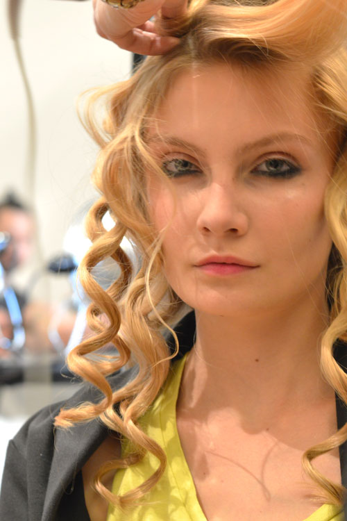 Backstage at Cynthia Rowley #NYFW. Lead hair stylist Staci Child partnered with Rowley and REDKEN to create this look. The theme: beachy rocker chic. The method: create super tight separated curls, let cool, brush everything out and sweep to the side. Spray to finish.  (on the 'to try' list - probably more doable than these braids) Make up by Stlia Images Cult of Pretty -Kristin