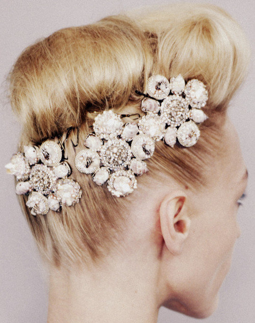 Why don't you …     Collect rhinestone brooches  at the flea market and pin them in your hair for holiday parties?    Image: Chanel Haute Couture (Spring 2008)