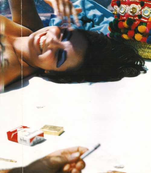 Throwback: Elizabeth Taylor by Bert Stern.  Just do that eye makeup on the beach.     Also the bag.     via