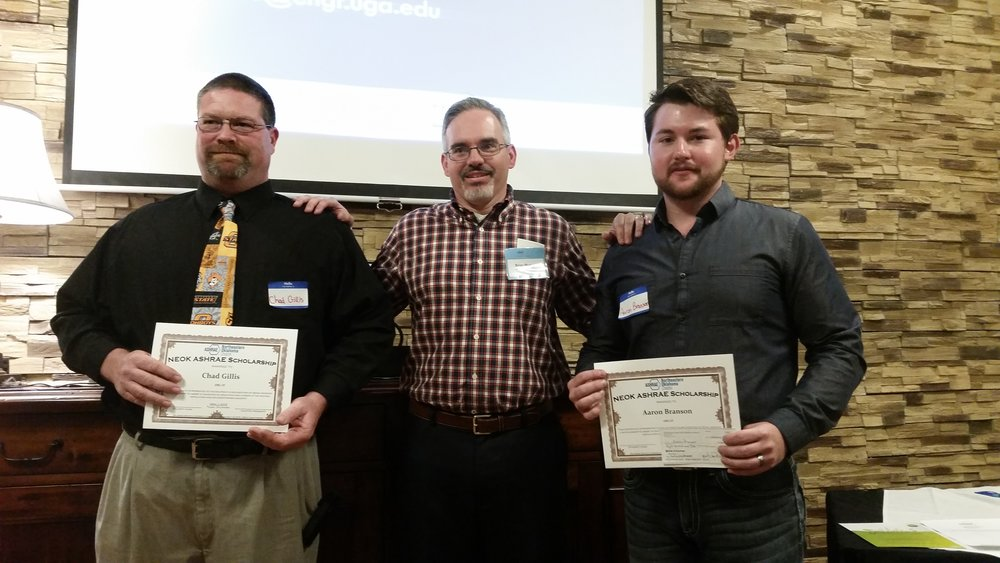 NEOK Scholarship Recipients: Chad Gillis (left) and Aaron Branson (right) with Student Activities Chair Brian Murray.