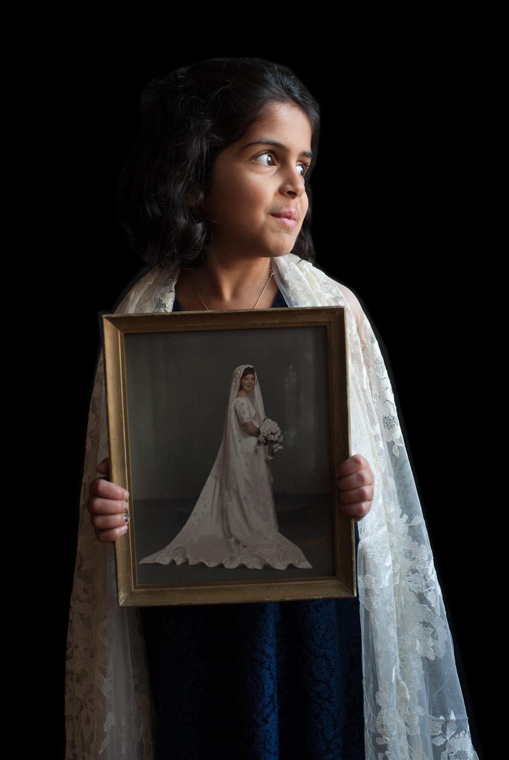Amelia wears Charlotte's wedding mantilla and holds Charlotte's wedding portrait.