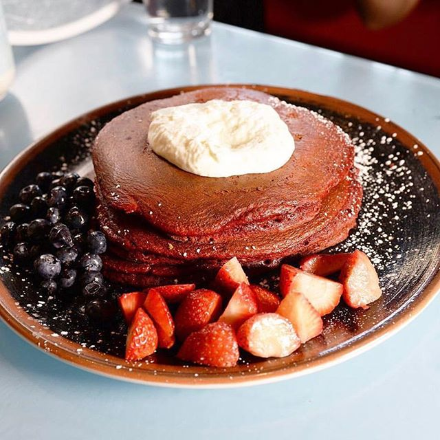 Do your morning right with our delicious red velvet pancakes; they're the perfect treat this holiday season! 🎄