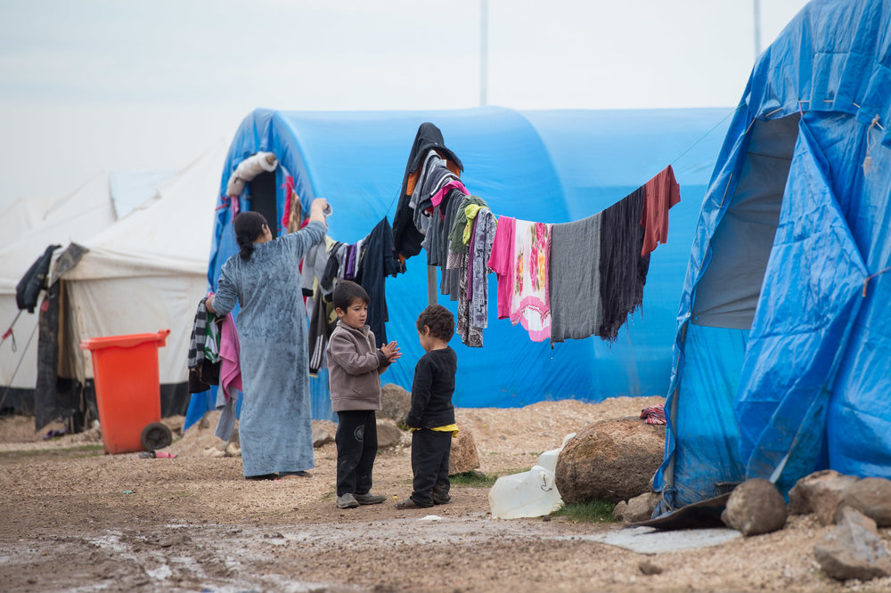 children play in refugee camp GOOD.jpg