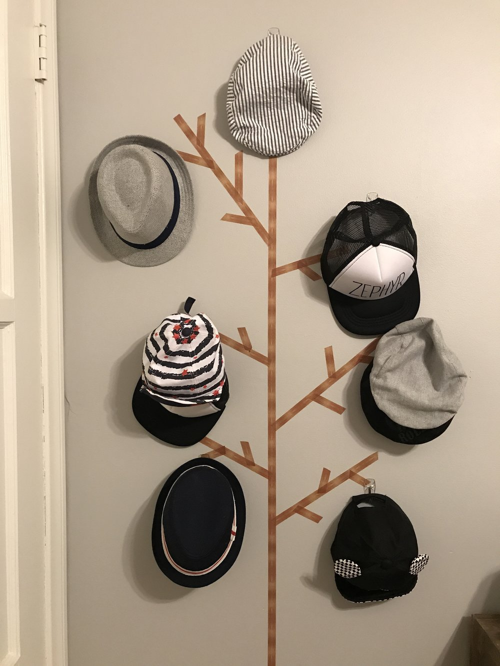 DIY Hat Rack!!! - This project only cost me $11 and took about 10 minutes to complete.