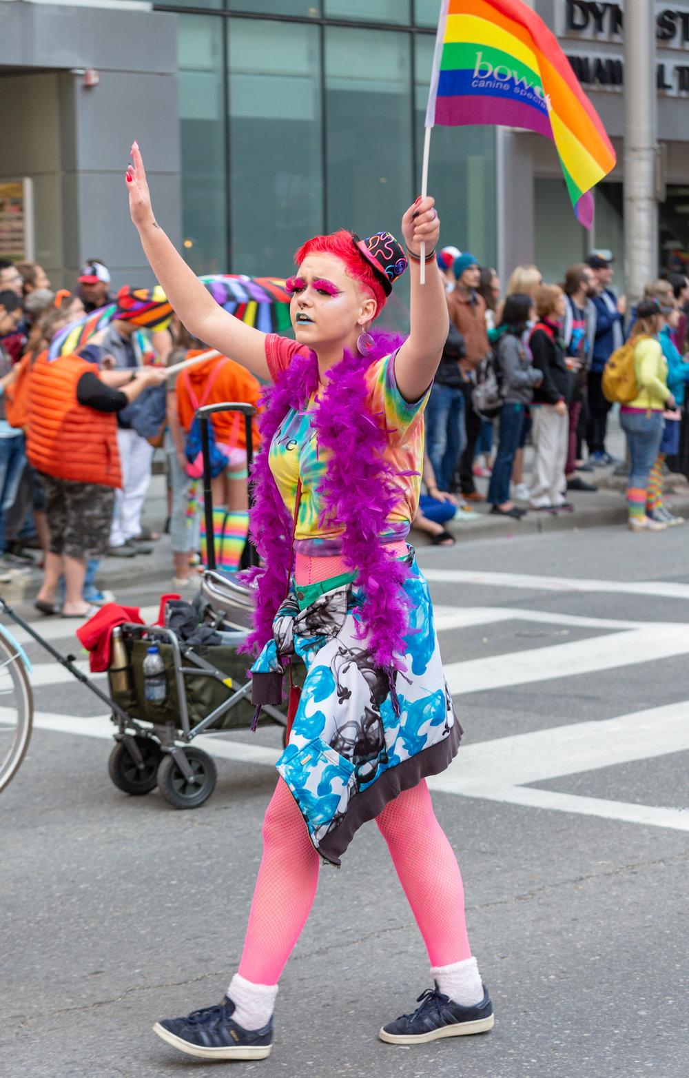 Girl waving pride flag2.jpg
