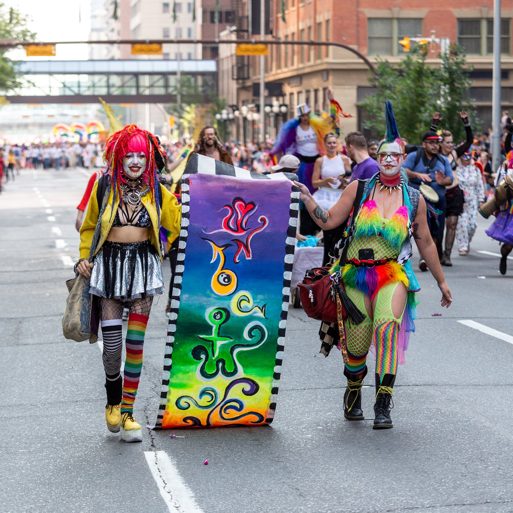 Painted girls carrying banner1.jpg