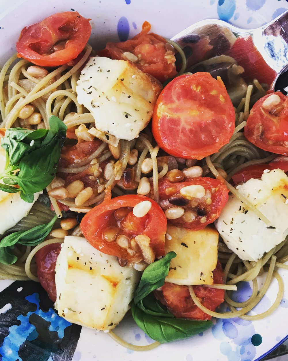 Spaghetti integrale di grano duro, with cherry tomatoes, pine nuts,haloumi cheese and basil leaves