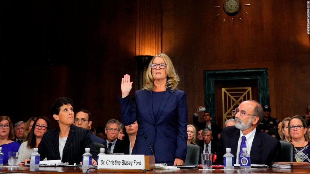 Dr. Christine Blasey Ford, one of three women accusing Judge Kavanaugh of sexual assault or misconduct, swears in before her testimony to the Senate Judiciary Committee
