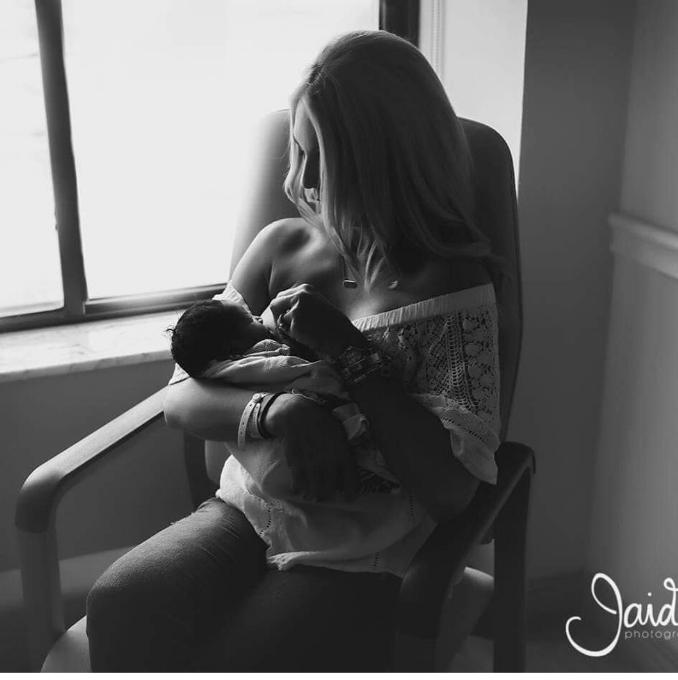 Adoptive breastfeeding at 48 hours.