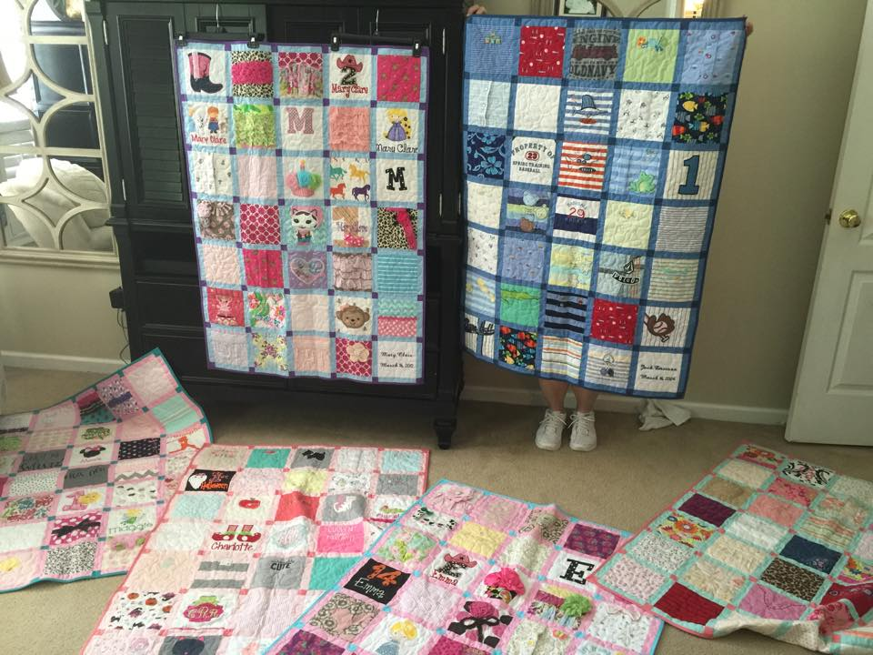 The baby outfit quilts I had made for all six of my biological children. Since I decided to do this only a few years ago, I did mix some then toddler clothes in with my older children's quilts. I also had a quilt made of my husband's professional baseball shirts.