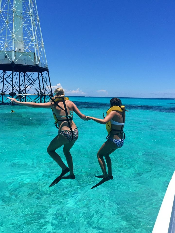 Macarena and my oldest daughter jumping off a snorkeling boat in the Florida Keys.