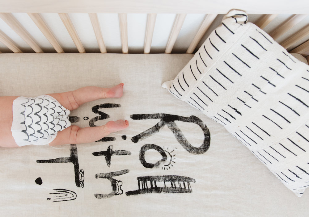 Roll With It Linens:  Dazed But Amazed  / Mud Cloth Pillow:  Loom Goods  / Diapers:  Parasol