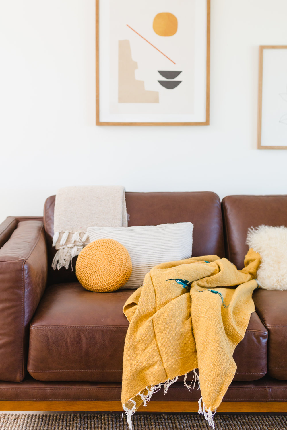 1. Couch Update - Add a new pillow or throw blanket to change the styling of your couch for an easy way to add a fresh new look.