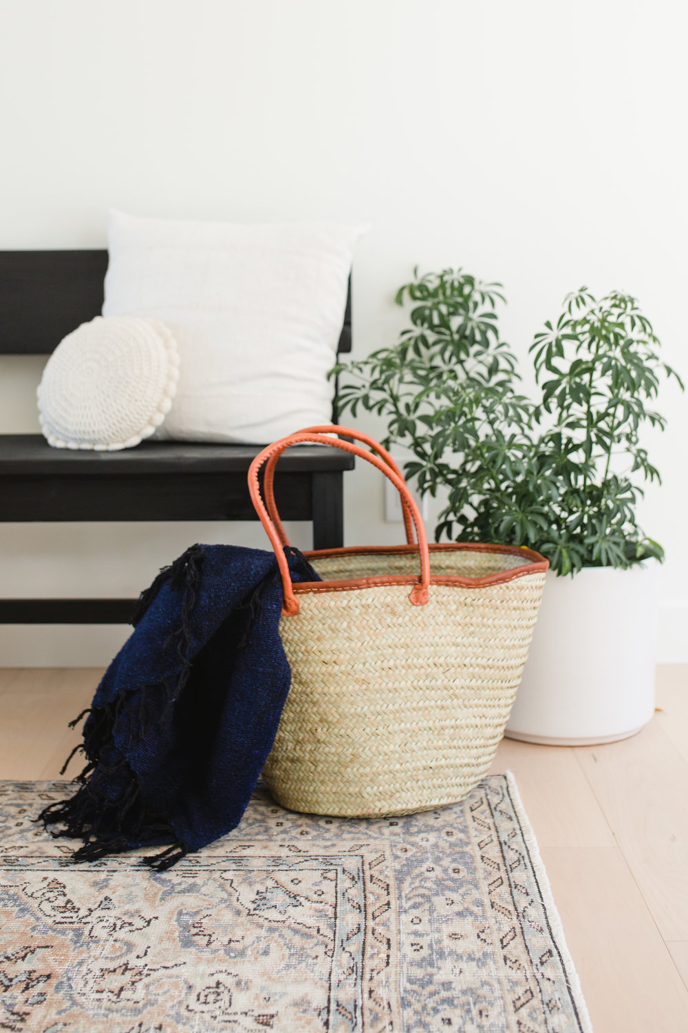 3. Catch It All - Add a basket to your space to catch all of the loose items in a room like throw blankets, shoes, etc.
