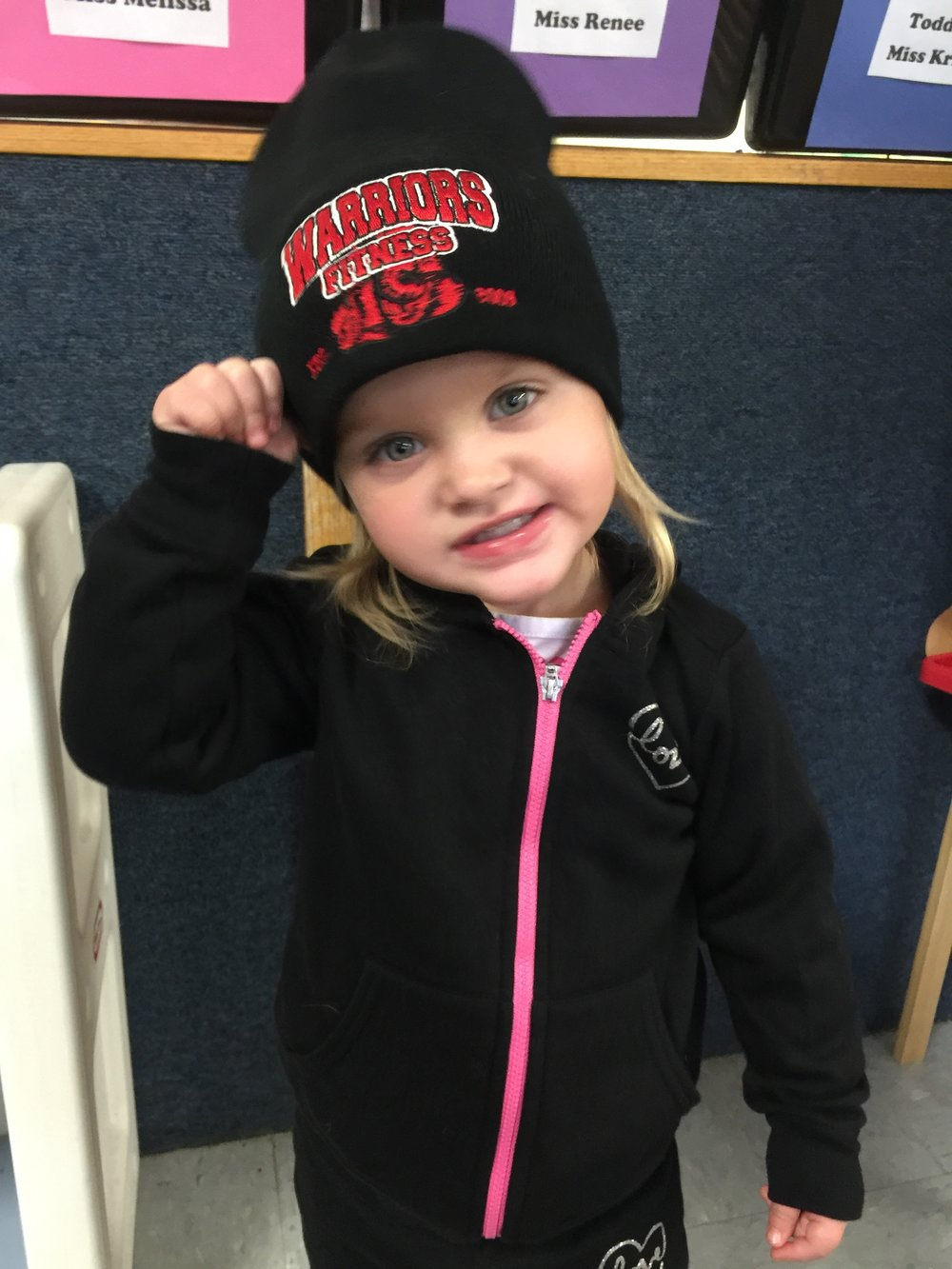 little girl in warriors fitness hat.JPG