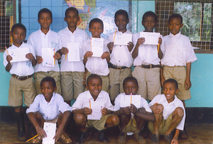 A handful of students taking a picture with their pen-pal items! =)