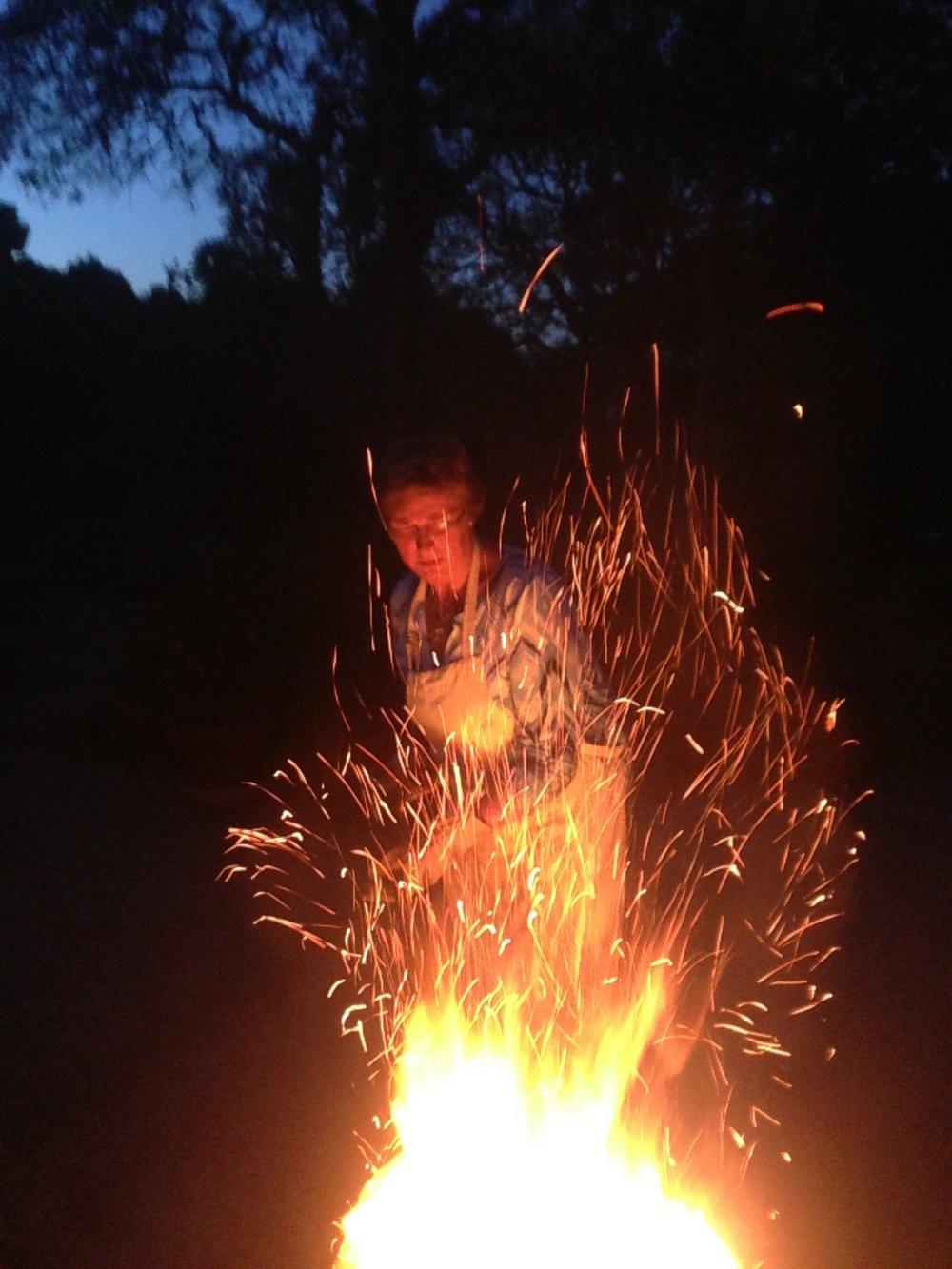 2013 Nov, Swan burning papers.jpg