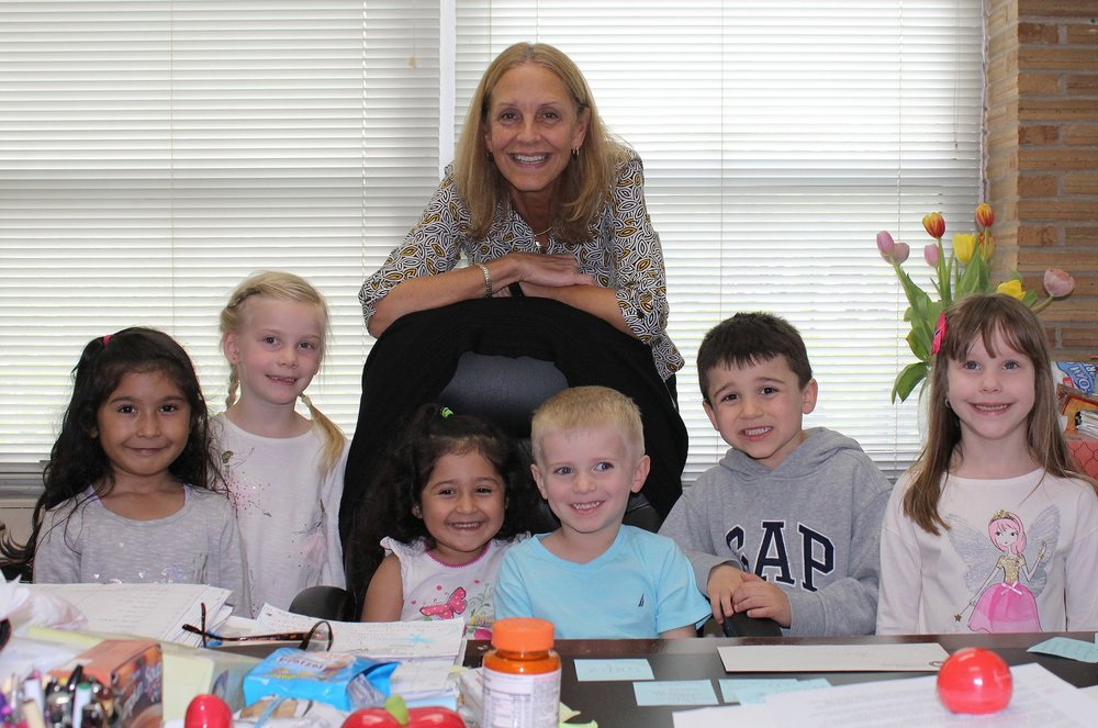 Principal Eva Panczyk with some Pre-K students at the end of a fun day!