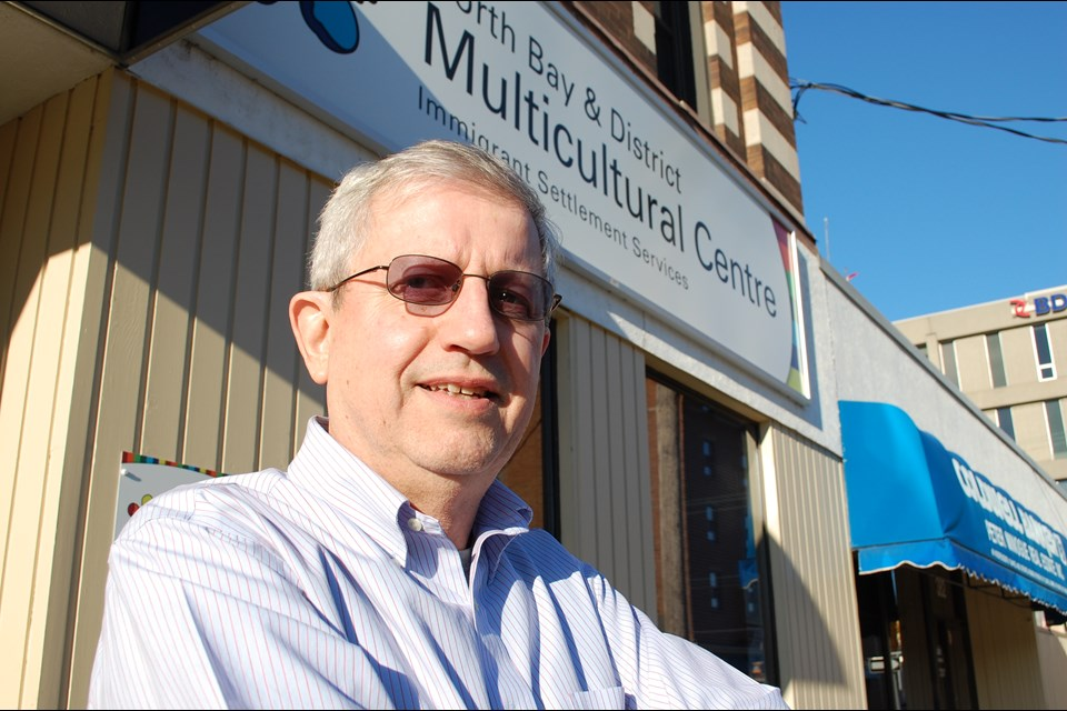 Former Executive Director Don Curry standing in front of our first location at 374 Fraser Street, North Bay ON