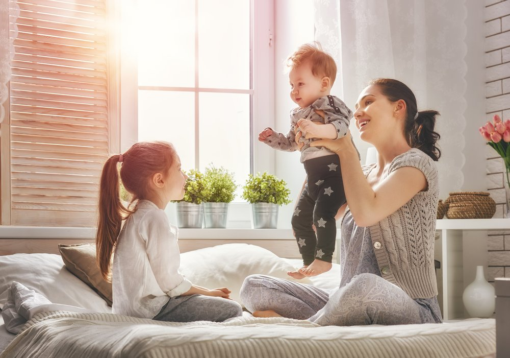 mother-playing-with-her-two-kids