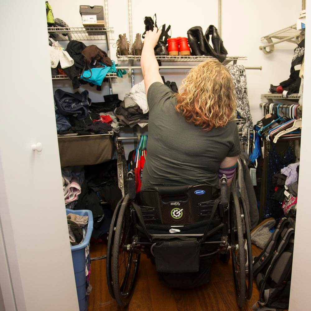 Sarah enjoys a roll-in closet with everything within reach.