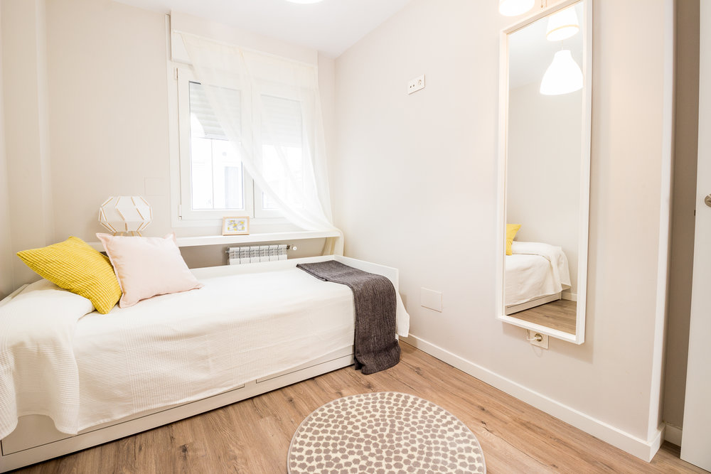 Staged4more Staged Home Tour A Young and Fresh Rental Apartment in Spain After bedroom.jpg