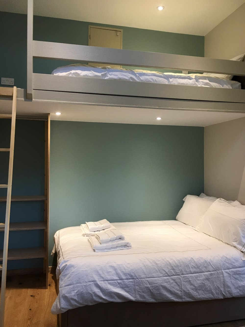Bedroom 2. A double bed and a single bunk above