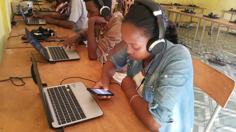 Bethelehem Yonas downloads learning materials to her phone to use after class. Yonas shares this material with other girls who aren't able to come to the Learning Labs.