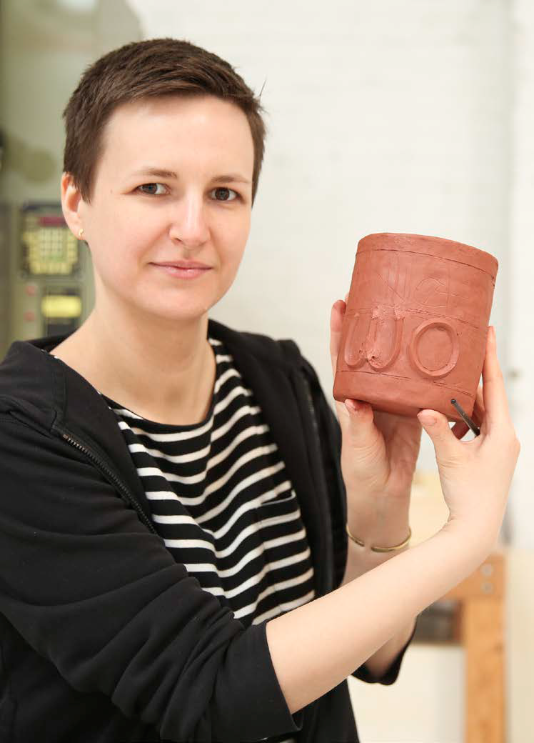 Karolina with her in-progress ceramic work.