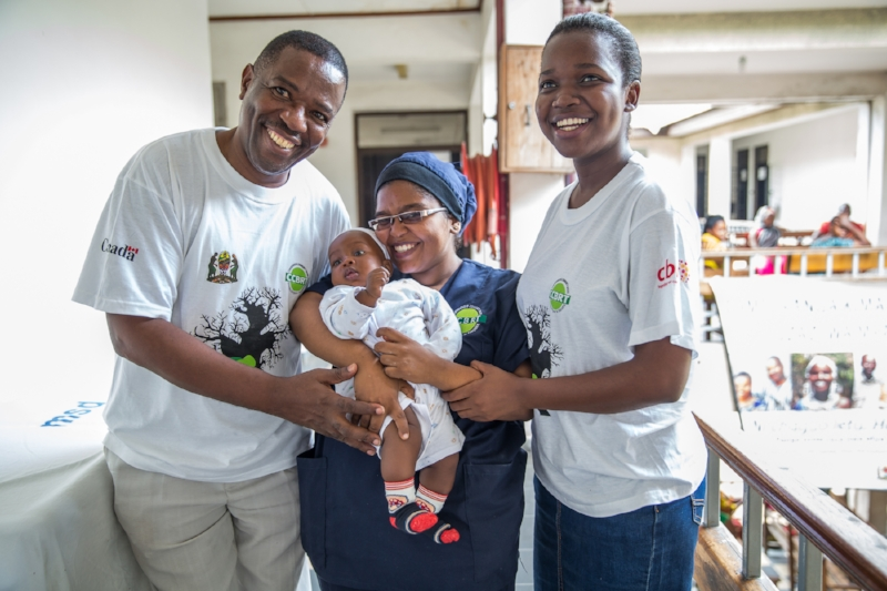 CCBRT staff celebrating the progress of this healthy baby at a partner facility. Photo Credit: Sala Lewis