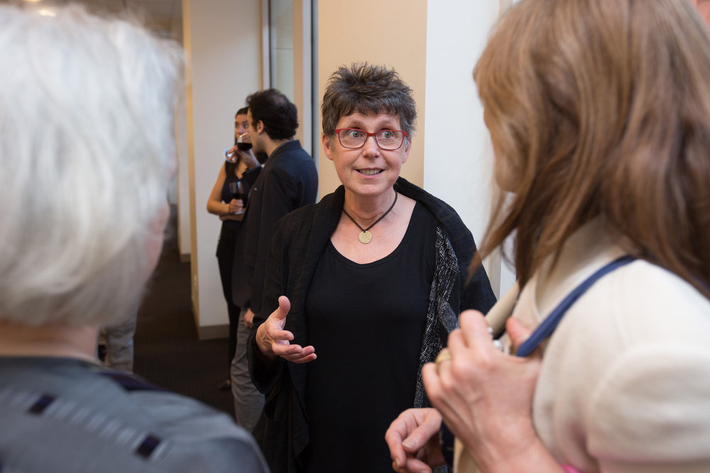 Artist Jac Saorsa with guests at the Drawing Out Obstetric Fistula exhibition opening at NYU. Photo credit: Todd Plitt
