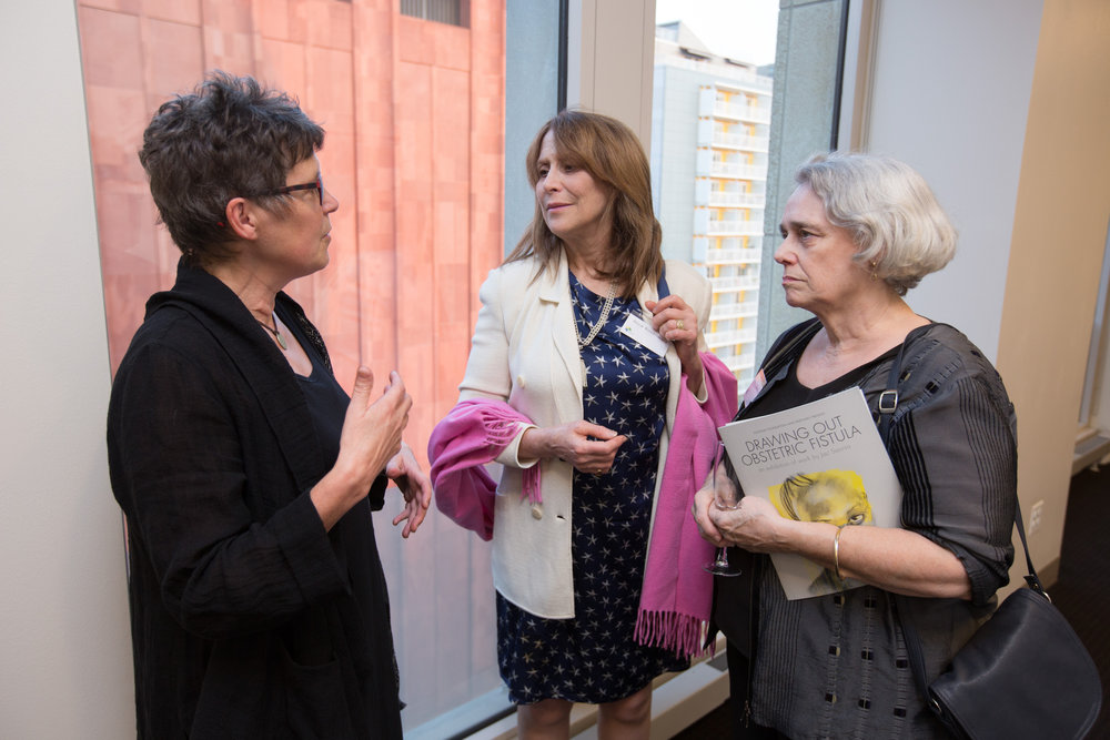 Artist Jac Saorsa discussing her work with guests.                         Photo credit: Todd Plitt