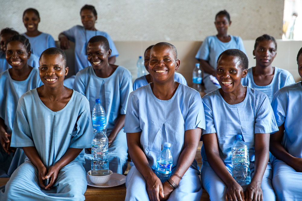 Women recovering from fistula at CCBRT's hospital share a smile. Photo credit: Sala Lewis