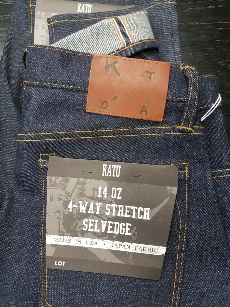 VINTAGE INSPIRED STRETCH DENIM 14oz4-Way stretch denim by Kato' Brand. The worlds first 4-way stretch.This 14oz middleweight '4-Way' stretch denim from Kato' Brand is the worlds first denim that stretches vertically as well as the usual horizontal stretch. This denim was painstakingly crafted to emulate the look and texture of vintage denim.A 4-Way Stretch Selvedge that emulated vintage denim was the vision of Nick Noguchi. Nick worked with Kaihara Mill for a year to develop the fabric. Nick knew he wanted to produce a stretch denim on old vintage shuttle looms.No other miles wanted to work with him because using old shuttle machine and weave stretch in the war and weft was a crazy idea for them.2way was possible to weave, but all the mills said weaving 4way stretch in old shuttle machine was not possible.Part of the difficulty was that Nick wanted the spacing between the warp yarns to be right, with most stretch denim the wefts elasticity pulls together the warp so very little weft shows through the warp side, making a flatter surface that looks different then 100% cotton denim.Nick wanted the denim to look and feel like a vintage reproduction denim, testing out different weaves to get the right amount of weft popping through the warp.This denim has been rope dyed with pure indigo and topped of with a slight redcast, to give it another vintage touch. After one month of wear it is clear that this will be a slow fader, which will give the denim low contrast fades and very vintage look.This denim is very soft and probably the most comfortable denim I own. Because the stretch yarns are wrapped with cotton (India x USA x Pakastan), the hand feel is virtually indistinguishable to 100% cotton jeans, unless of course you give is a stretch. The great thing about this denim is that it retains its shape and actually has much less blow out in the knees than 100% cotton denim, so the slim tapered fit is achieved without the baggy knees, which happens to virtually every pair of 