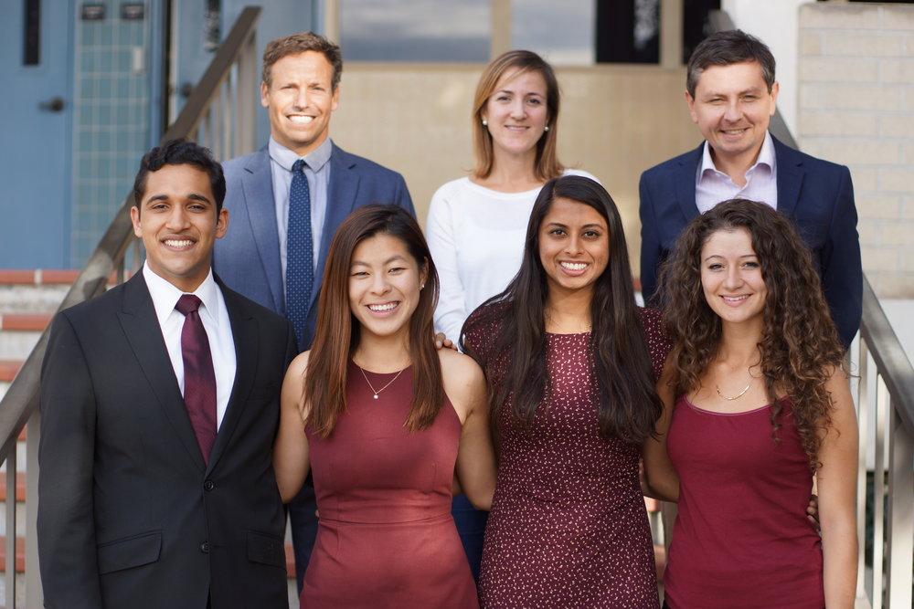 HULT PRIZE AWARD-WINNING TEAM:  From left to right, Winning Team (front) : Umar Farooq '17, Vanessa Liu '17, Khadija Hassanali '17, and Sarah Sanbar '17 ; From left to right, Judges (back row): Scott Sherman, Carolina Sheinfold, and Mietek Boduszynski