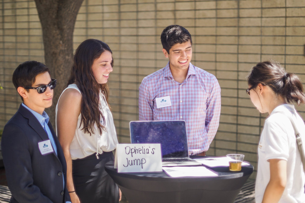 Photo of SOURCE students interacting with guests at the Annual SOURCE Symposium