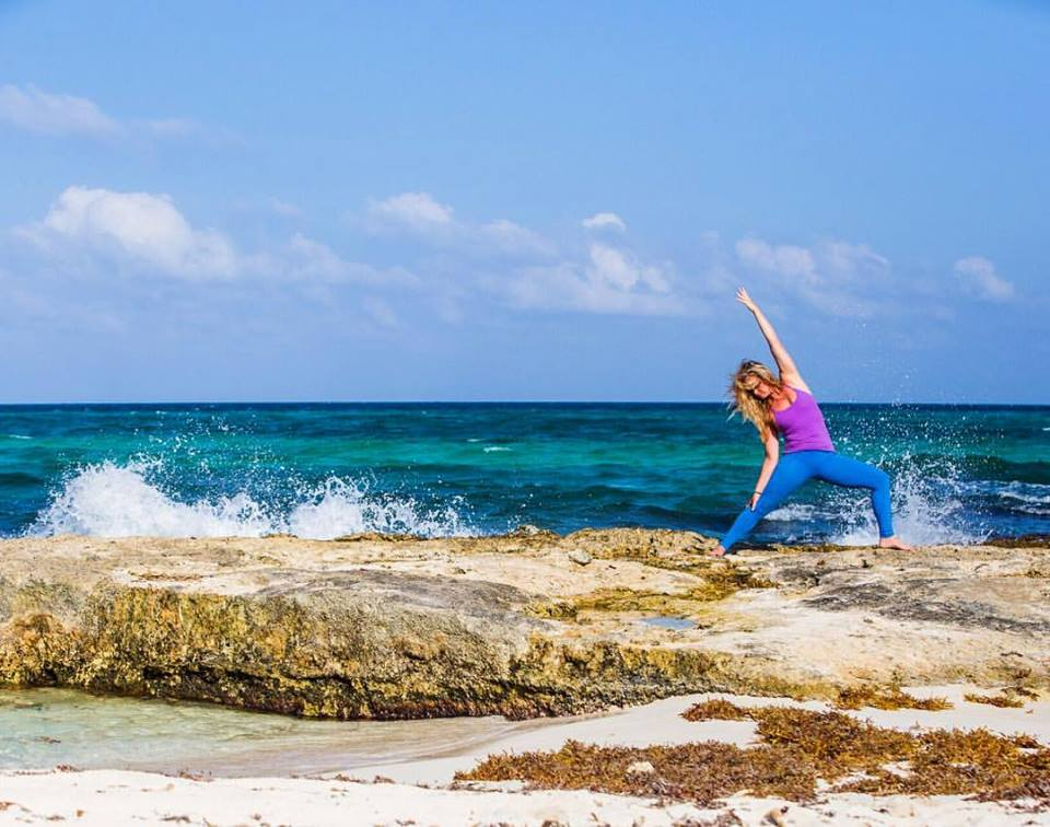 Mary in Reverse Warrior on rock in Tulum 2016.jpg
