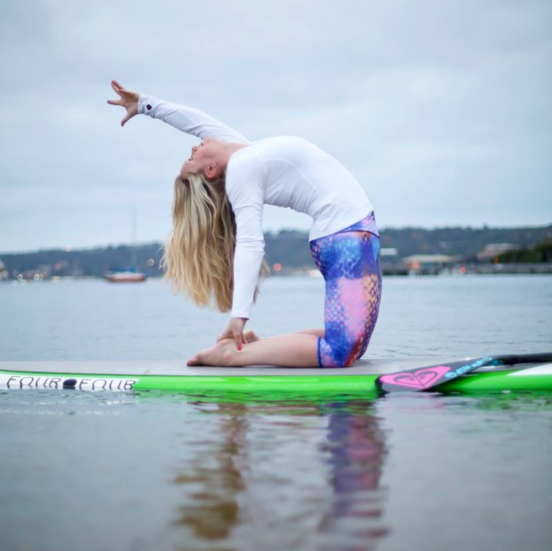 Mary Susan on sup in camel pose-san diego.jpg