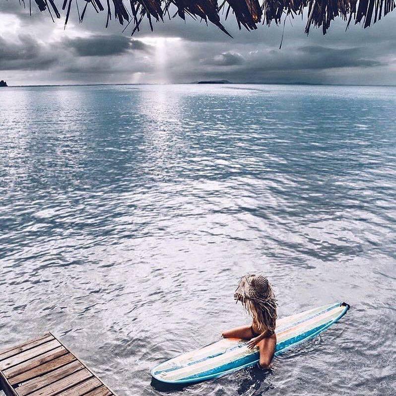 mary in cr sitting on surf board.jpg