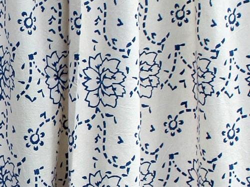 Block-printed Pattern - I stumbled upon Tilonia, a fair-trade artistan enterprise featuring enticing textiles produced with designs and production methods grounded in Indian craft tradition. I particularly fell in love with the block-printed table linens and shower curtains, one of which is shown here.Tilonia works in partnership with the U.S. based Friends of Tilonia, Inc. to provide nearly 400 artisans with supplemental income from sewing, needlework, embroidery, tie-dying, block printing, and weaving.Anna's Pick: Tilonia - Shower Curtain - Belle Isle Blue (On sale for $59.95). Image Source: tilonia.com.