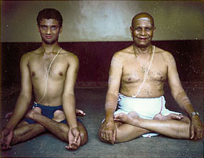 R. Sharath and Sri K. Pattabhi Jois in Mysore, 1997. This was one of the early photos taken for the English edition of Yoga Mala by Sri K. Pattabhi Jois, published in 1999. (Yoga Mala was written, in Guruji's native language Kannada, in 1958.)   Photo by Stephan Crasneanscki / Used with permission: Eddie Stern