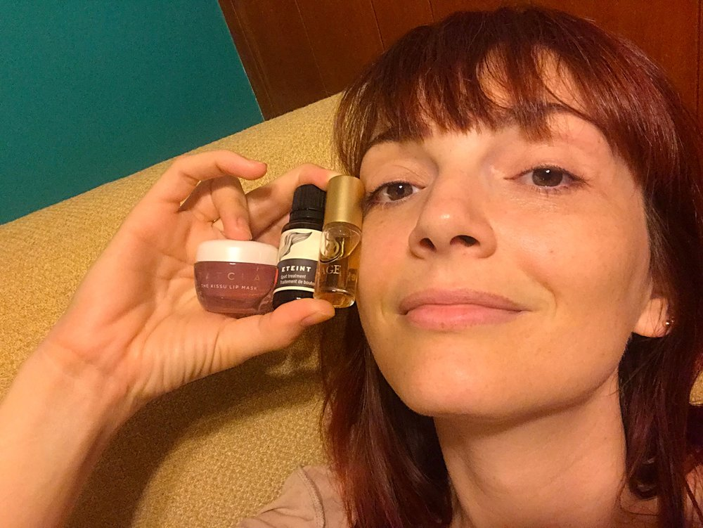 Jackie Johnson with Tatcha The Kissu Lip Mask, Stark Eteint Spot Treatment, and Topaz Perfume Oil.