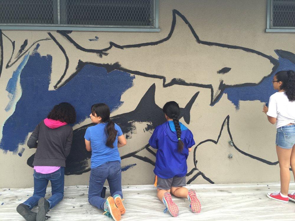 Kids painting the shark mural 1